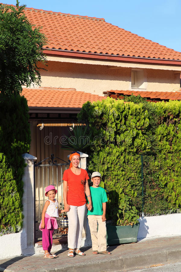 Mother With Children Near House Stock Image