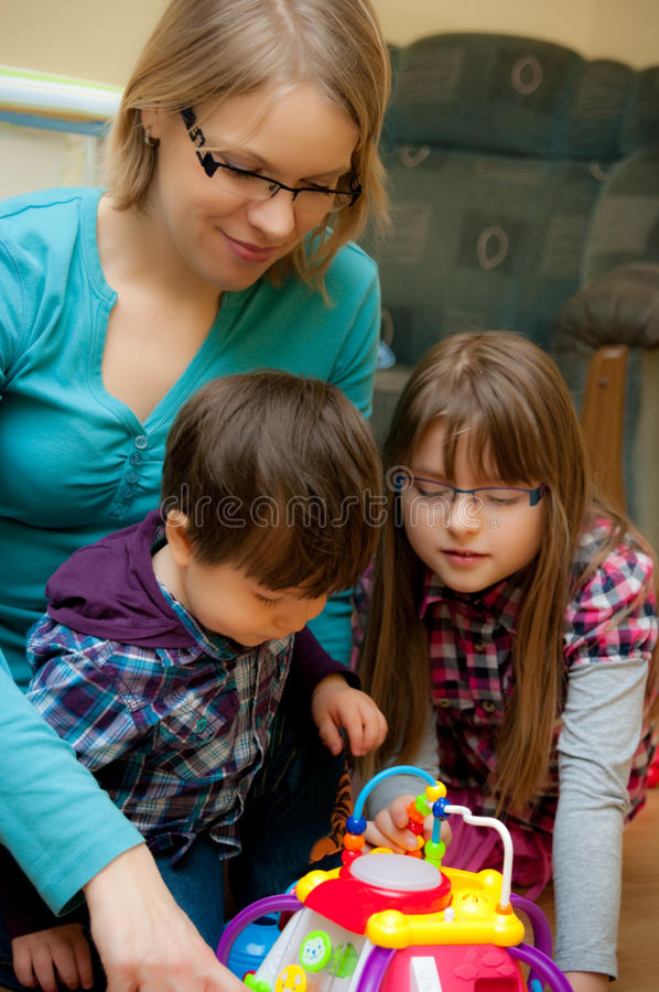 Mother and Children Playing stock images
