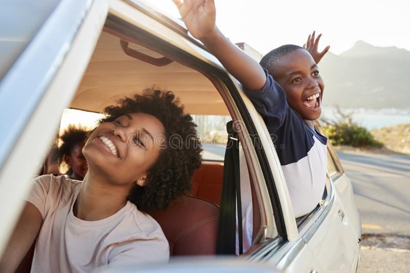 Mother And Children Relaxing In Car During Road Trip stock photography