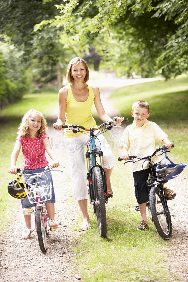 Download Mother And Children Riding Bikes In Countryside Stock Image - Image of camera, cyclist: 10971529