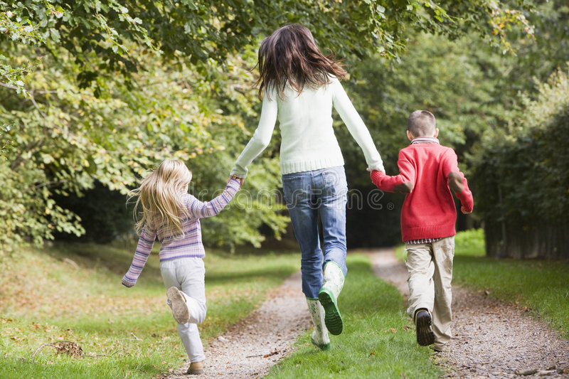 Download Mother And Children Running Along Woodland Path Royalty Free Stock Images - Image: 5309229