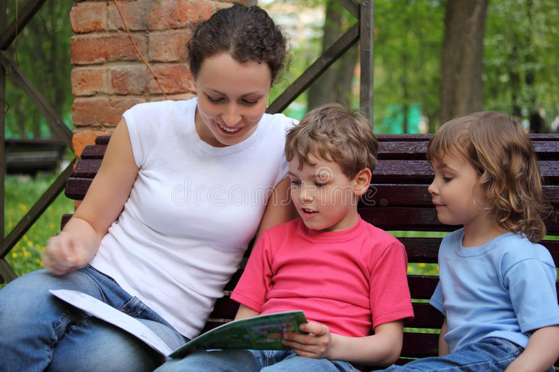 Download Mother With Children Sit And Read Book Stock Image - Image: 9873351