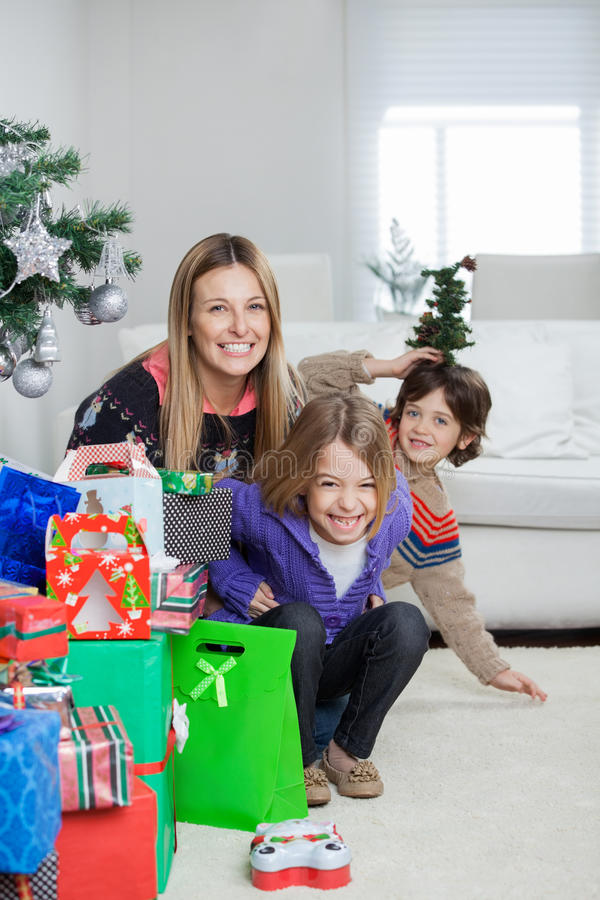 Mother With Children Sitting By Christmas Gifts royalty free stock photography