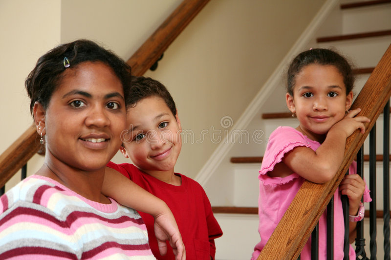 Mother and Children on Stairs royalty free stock photo