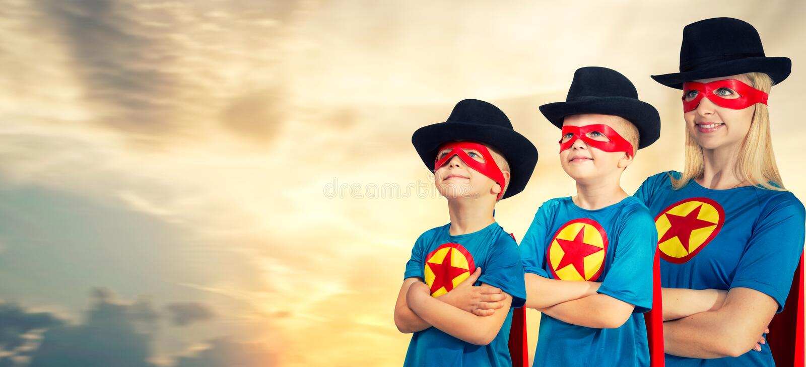 Mother and children in superheroes costumes. stock photos