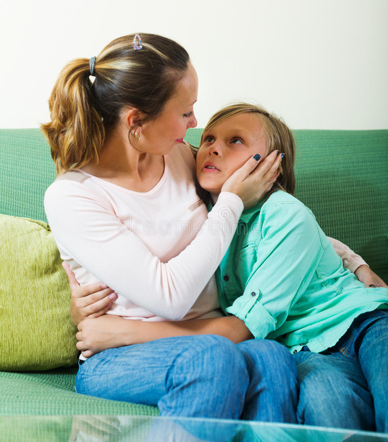 Mother comforting teenage son royalty free stock photography