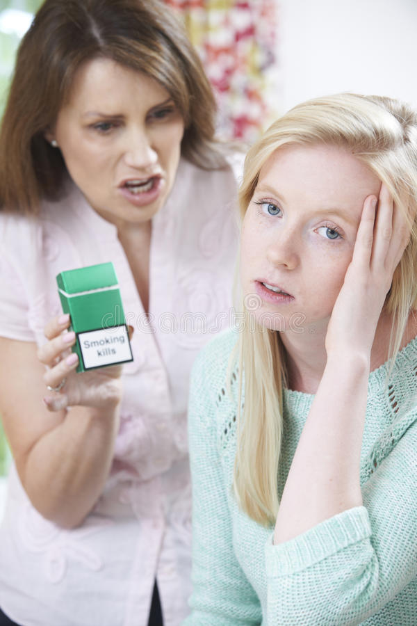 Mother Confronting Daughter Over Dangers Of Smoking. Mother Confronting Teenage Daughter Over Dangers Of Smoking stock photo