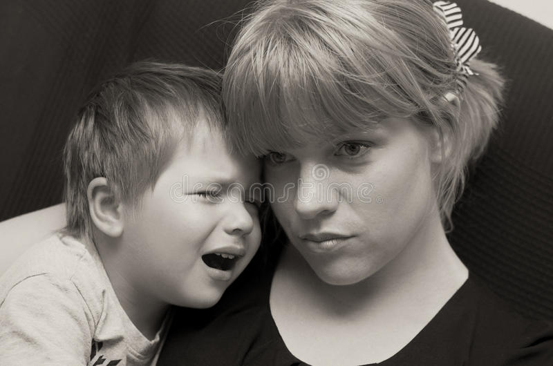Mother and crying child stock photography