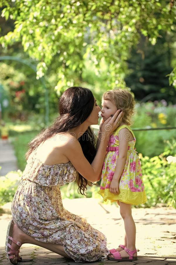 Mother cuddle baby girl in park outdoor royalty free stock photo