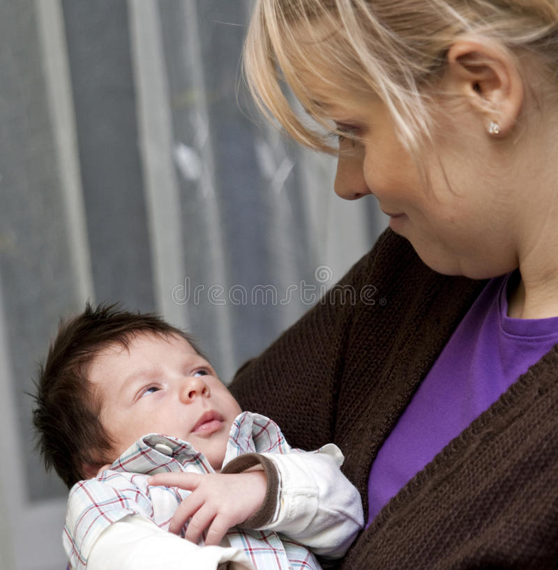 Mother cuddling newborn baby royalty free stock photos