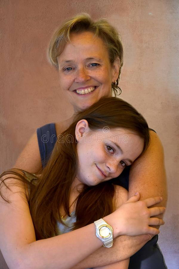 Mother and cute teenage daughter stock images