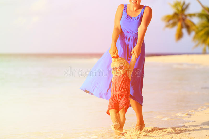 Mother and daugher playing on beach. Mother and daugher playing on summer tropical beach stock photos