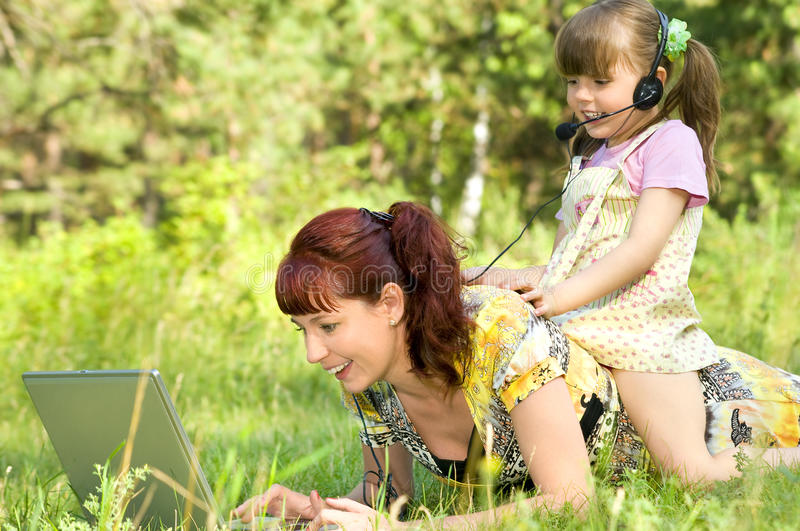 Download Mother and  daughte stock photo. Image of glade, computer - 10389300