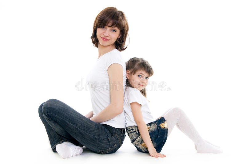 Mother and daughter. Mother sits with her doughter royalty free stock photos