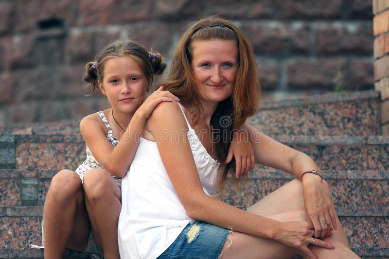 Mother with daughter stock images