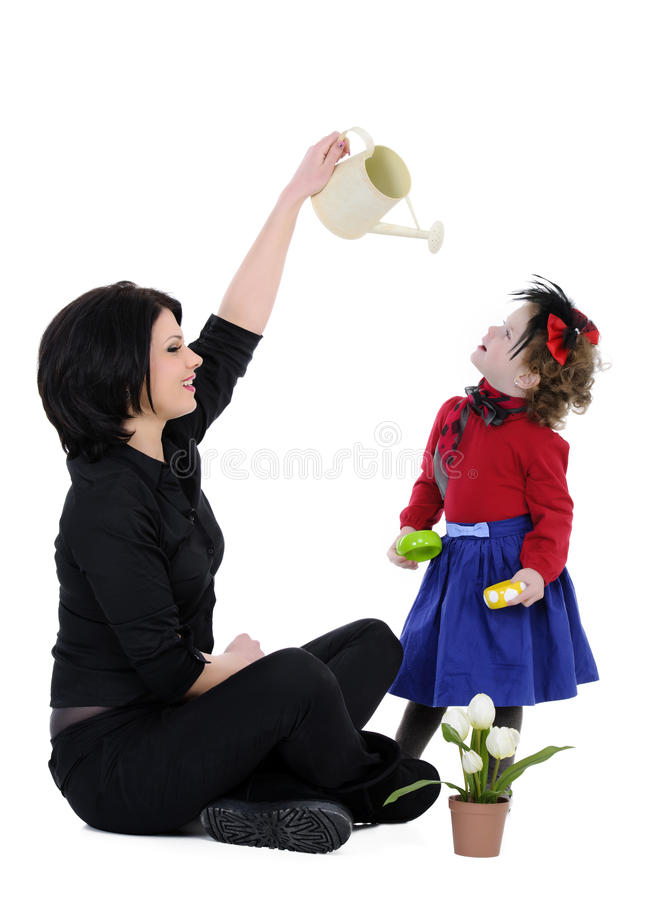 Mother and daughter. Beautiful mother with her daughter studio shoot stock photos
