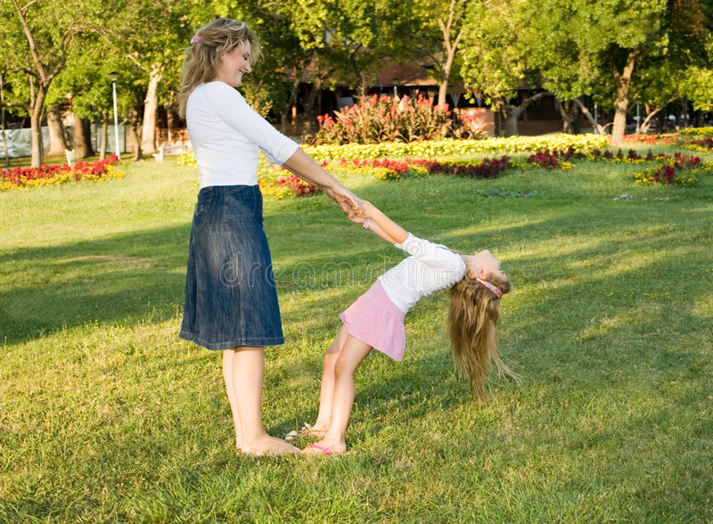 Mother and daughter. Playing at the park on sunny day royalty free stock photos