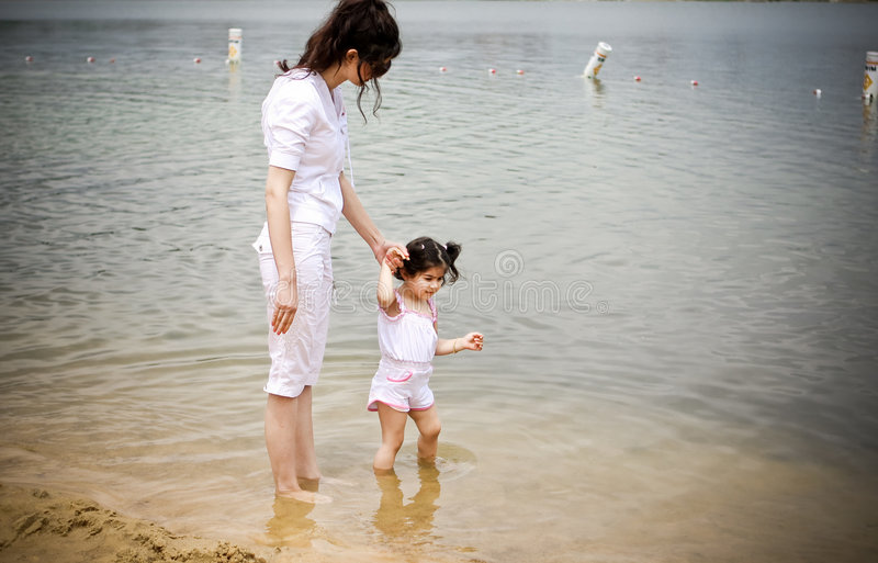 Mother and daughter. Holding hands at the beach stock photos