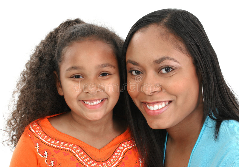 Mother and daughter. Portrait of smiling little girl with her mother royalty free stock image