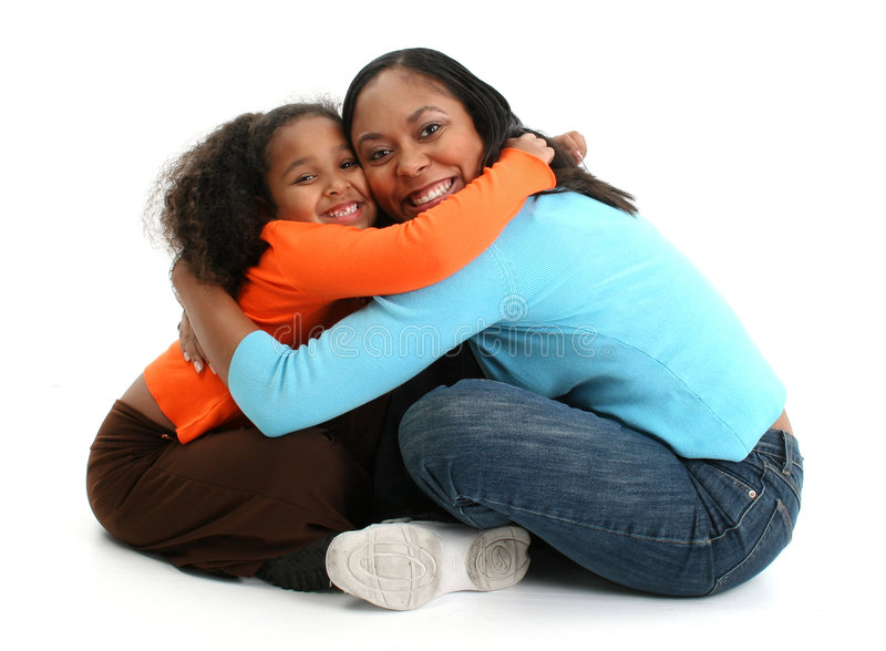 Mother and Daughter. African American mother and daughter sitting on the floor and hugging each other, on white studio background stock images