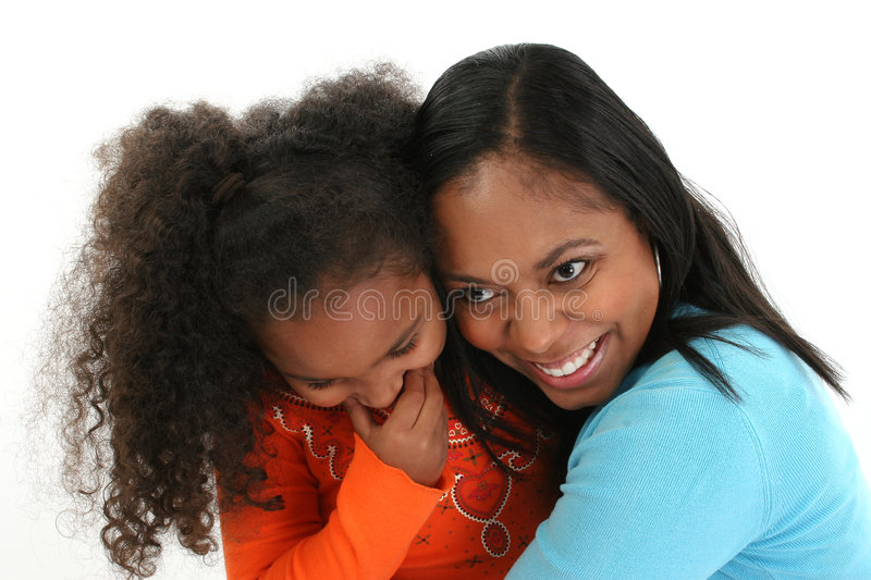 Mother and Daughter. A portrait of giggling daughter with her mother, on white studio background royalty free stock photo