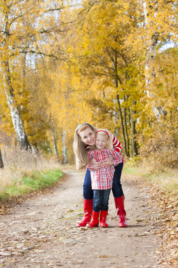 Mother And Daughter In Autumn Stock Photo