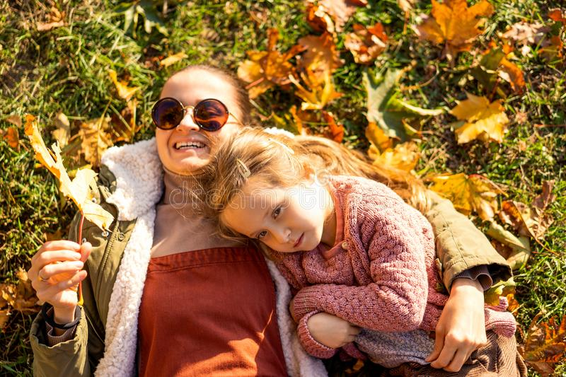 Mother with daughter in autumn park stock photos