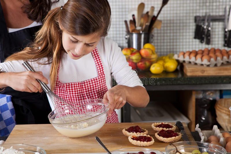 Download Mother And Daughter Baking At Home Stock Image - Image: 22276677