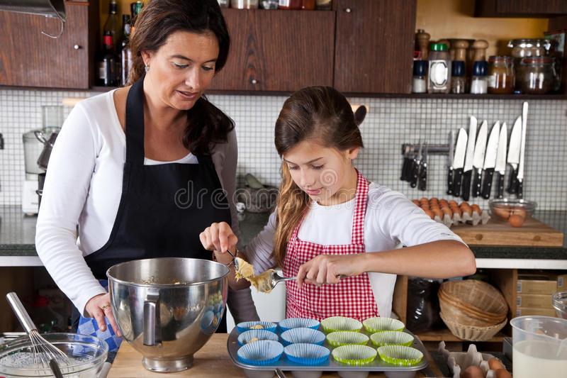 Mother And Daughter Baking At Home Royalty Free Stock Photos