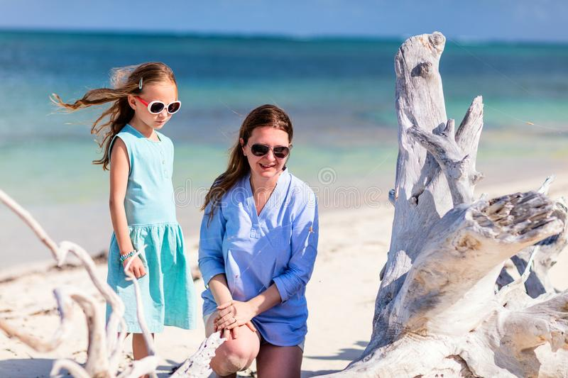 Mother and daughter at beach. Mother and daughter enjoying tropical beach vacation royalty free stock images