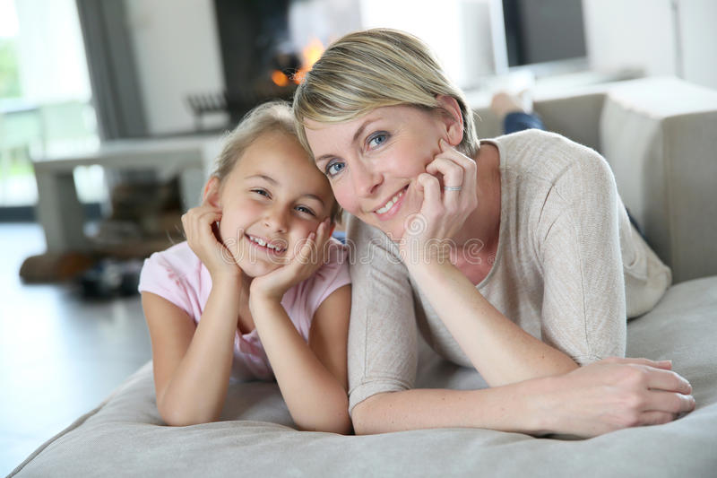 Mother and daughter being happy stock photos