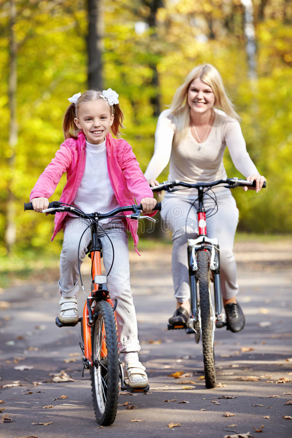 Mother and daughter on bicycle royalty free stock photos