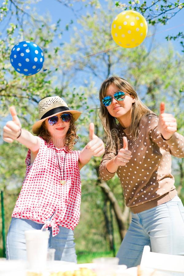 Mother with daughter on birthday garden party during summer stock photography