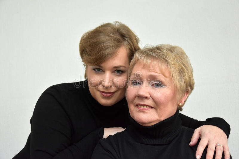 Mother and daughter. In black turtleneck sweater royalty free stock images