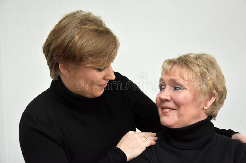 Mother and daughter. In black turtleneck sweater royalty free stock photography