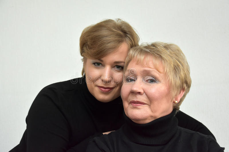 Mother and daughter. In black turtleneck sweater royalty free stock photo