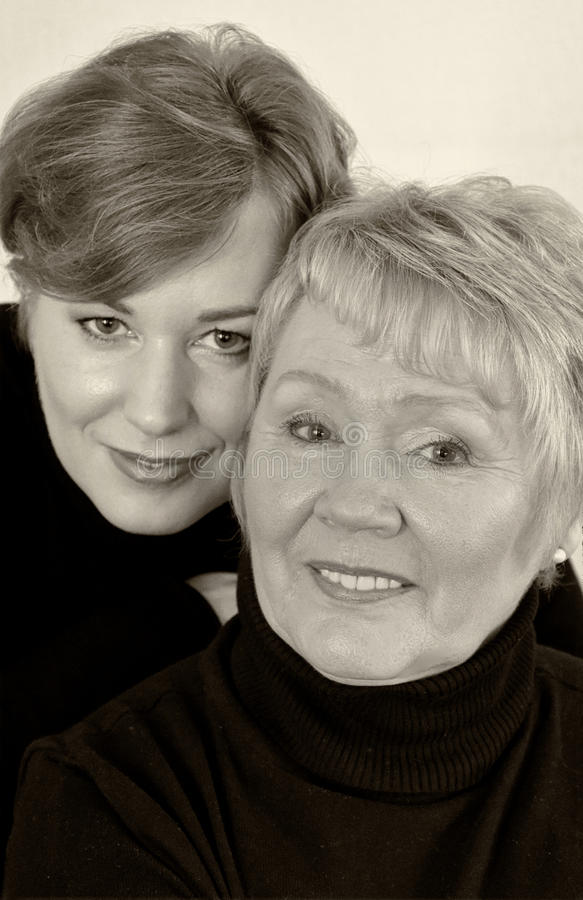 Mother and daughter. In black turtleneck sweater royalty free stock image