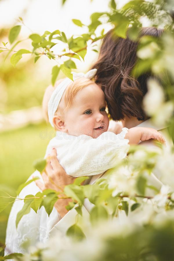 Mother and daughter in blossoming park royalty free stock images