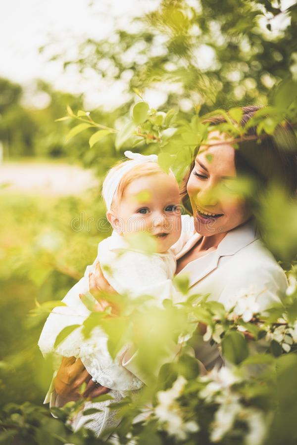 Mother and daughter in blossoming park royalty free stock photo