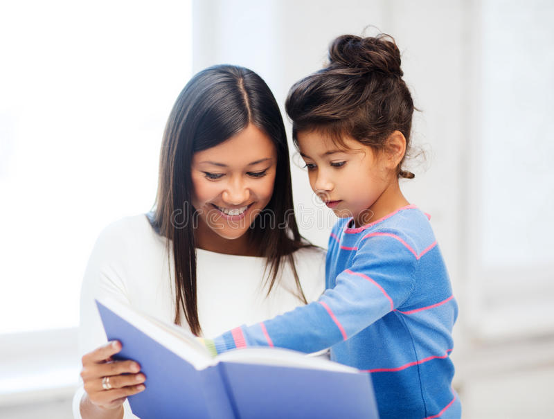 Download Mother And Daughter With Book Stock Photo - Image of asian, classroom: 34396840