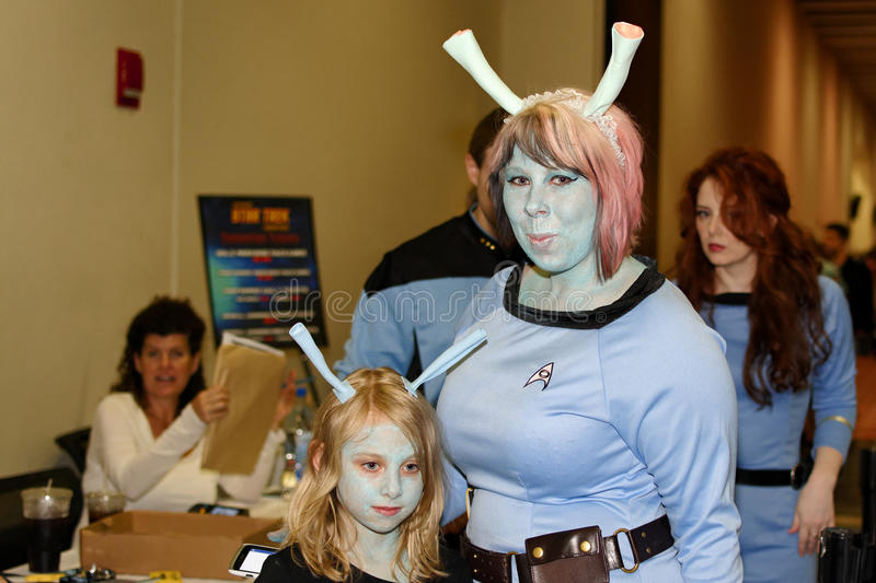 Mother and daughter. Boston, Massachusetts USA - June 6 2013 - Mother and daughter in Andorian costume during the official Star Trek convention Boston royalty free stock photos