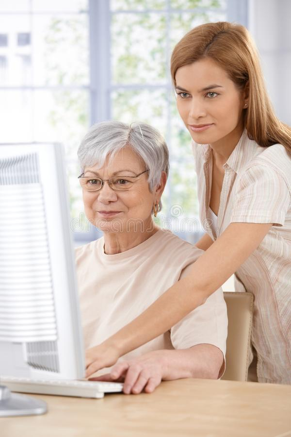 Download Mother And Daughter Browsing Internet Stock Photo - Image: 21534990