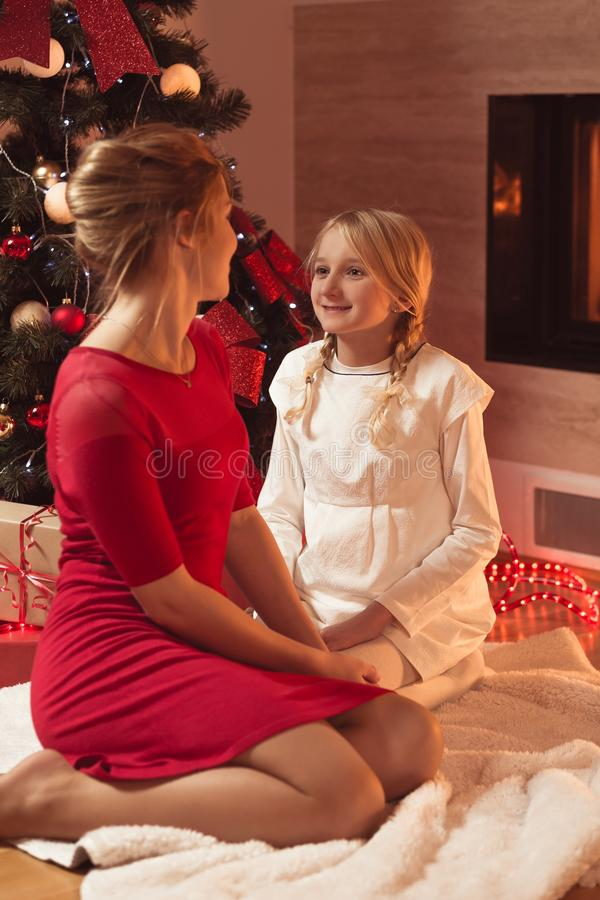 Mother and daughter celebrating christmas stock photos