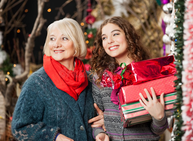 Mother And Daughter With Christmas Presents In royalty free stock photo