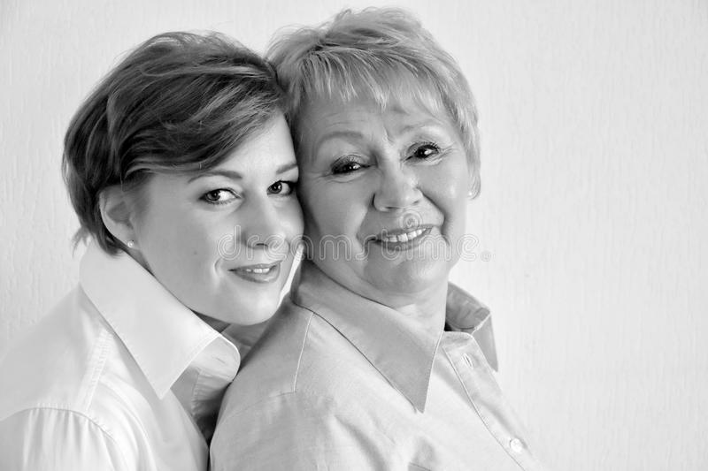 Mother and daughter. Close together posing for a photo royalty free stock image