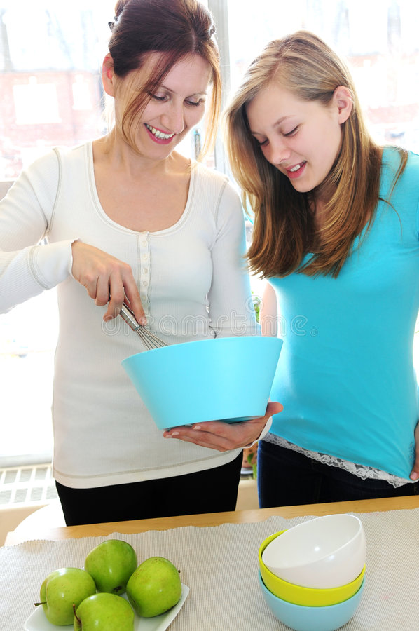 Mother and daughter cooking royalty free stock photos