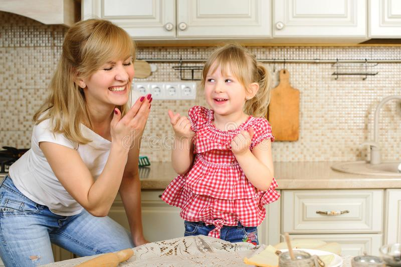 Mother and daughter cooking at home. Christmas biscuits. Sweet home. Merry Christmas. Happy Holidays. Family preparation holiday royalty free stock photo