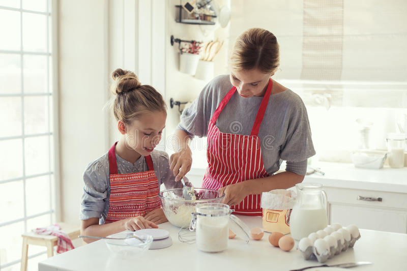 Mother and daughter are cooking royalty free stock photo