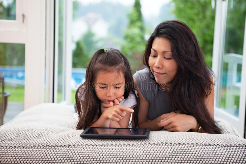 Mother and Daughter with Digital Tablet royalty free stock photos