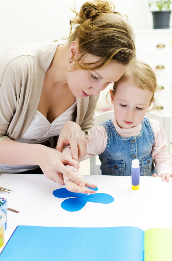 Mother and daughter doing handicrafts. royalty free stock photography